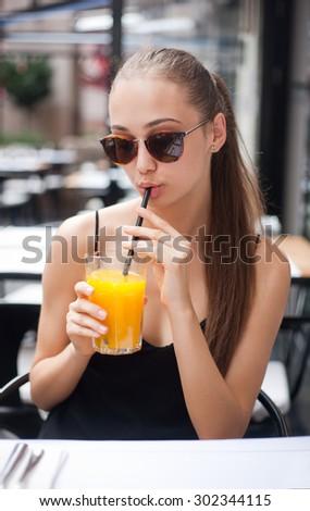 Young brunette woman having food fun in italian restaurant. - stock photo