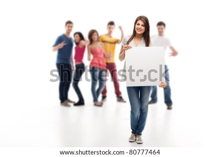 young brunette woman holding blank advertising banner in front of approving people - stock photo