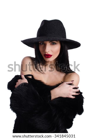 young brunette woman in a hat with red lipstick on a white background