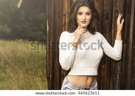 young brunette woman in the autumn