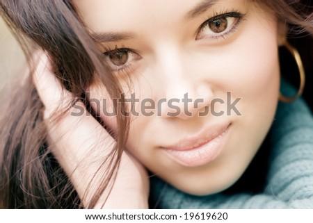 Young brunette woman outdoors portrait. - stock photo