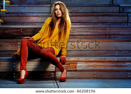 young brunette woman portrait in autumn color - stock photo