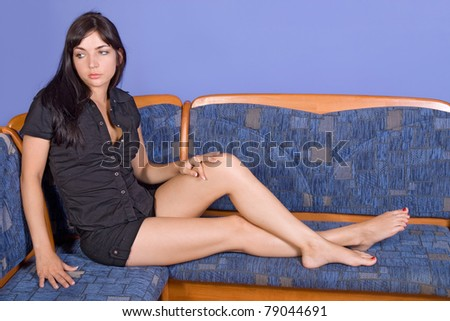 Young brunette woman sitting on bench