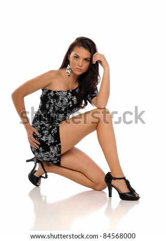 Young brunette woman wearing a dress isolated on a white background - stock photo