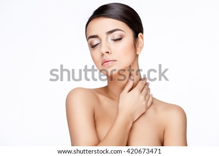 Young brunette woman with beautiful clean skin