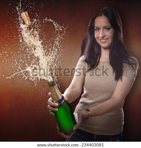 Young brunette woman with champagne bottle with explosion, celebration theme. - stock photo