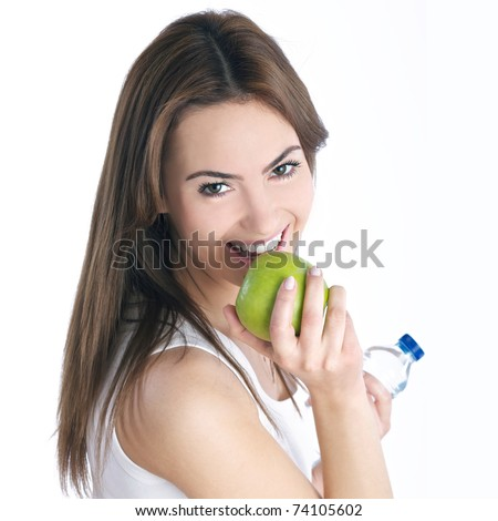 young brunette woman with green apple - stock photo