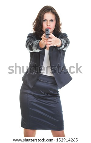 Young brunette woman with gun isolated on white - stock photo