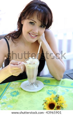young brunette woman with ice cream