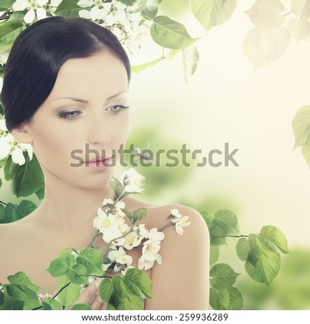 Young brunette woman with leaves - stock photo