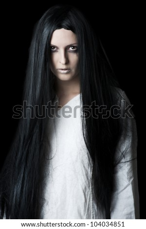 Young brunette woman with long black hair - stock photo