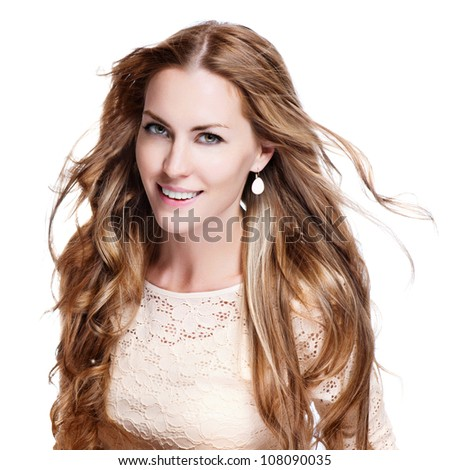 young brunette woman with long flying hair, studio shot - stock photo