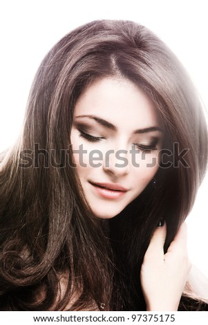 young brunette woman with long healthy shiny hair portrait, studio shot - stock photo