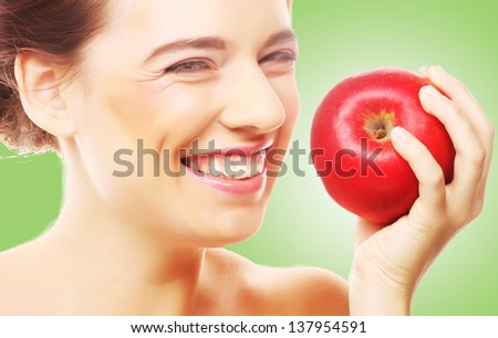 young brunette woman with red apple