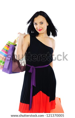 Young brunette woman with shopping bags isolated on white background - stock photo