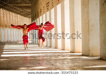 Young Buddhism novices are playing and relaxing at Shwezigon tem - stock photo