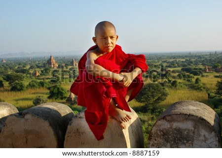 young buddhist monk on temple background