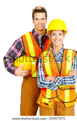 Young builder people  in yellow uniform. Isolated over white background - stock photo