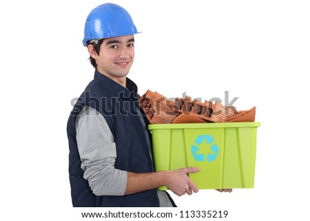 Young builder recycling - stock photo