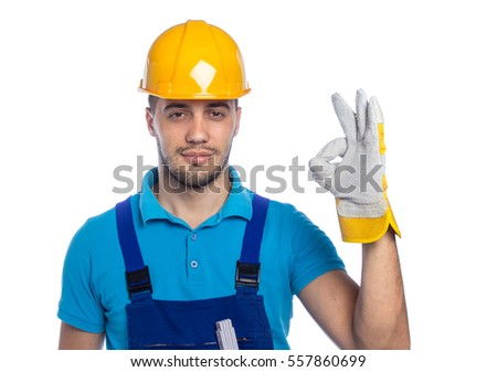 Young builder showing with fingers sign excellent, isolated on white