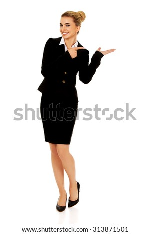 Young busiensswoman showing something on hand - stock photo