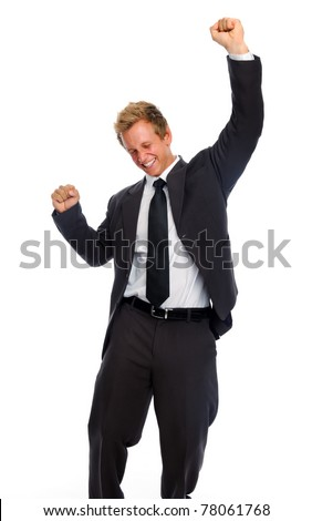Young business associate punches his fist into the air in victory - stock photo