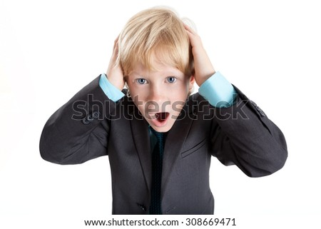 Young business boy grabbed his head with hands in horror, screaming, isolated on white background - stock photo