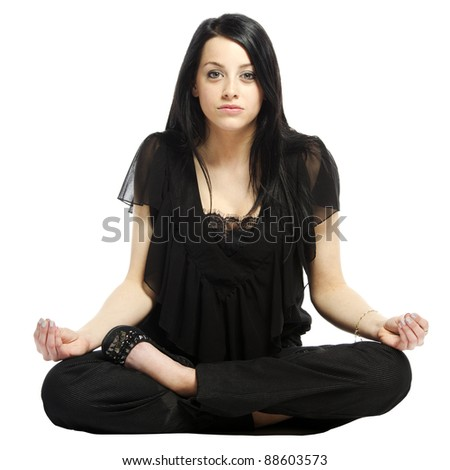 Young business casual woman in a lotus yoga position looking at camera - stock photo