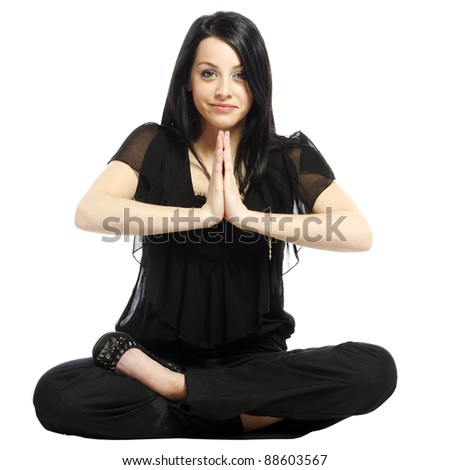 Young business casual woman in a lotus yoga position looking at camera meditating - stock photo