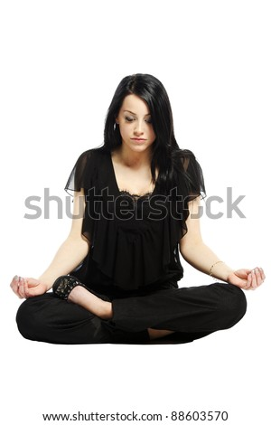 Young business casual woman in a lotus yoga position looking down - stock photo