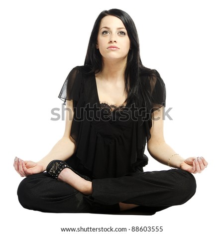Young business casual woman in a lotus yoga position looking up - stock photo