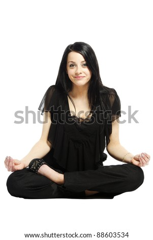 Young business casual woman in a lotus yoga position smiling - stock photo