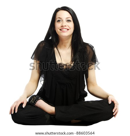 Young business casual woman in a lotus yoga position smiling against white background - stock photo