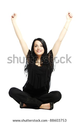 Young business casual woman sitting and excited with arms in the air - stock photo