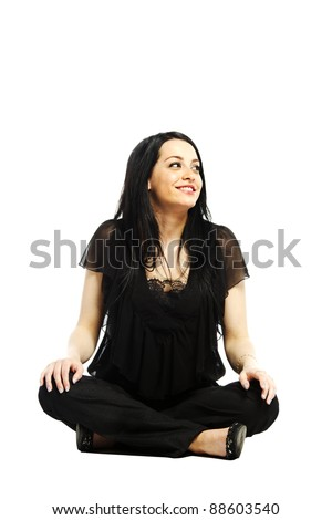 Young business casual woman sitting and looking to her left on white background - stock photo