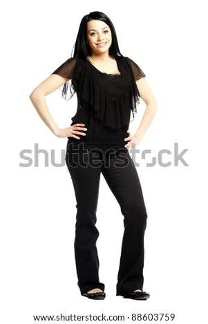 Young business casual woman smiling for camera against white background - stock photo