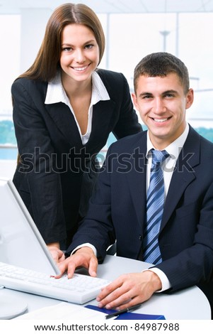 Young business colleagues in the workplace - stock photo