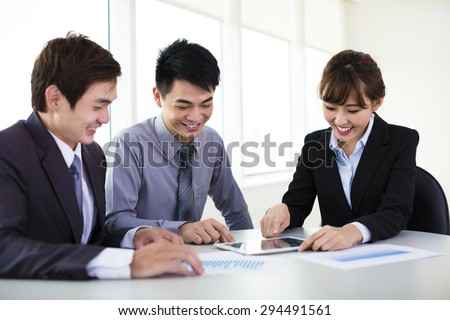 Young business colleagues working in the office - stock photo