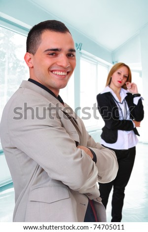Young business couple in the office - stock photo