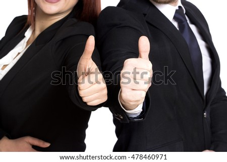 young business couple showing thumbs isolated on white