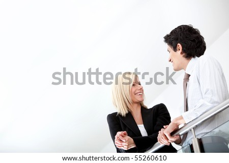 Young business couple talking at the office - stock photo