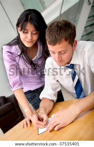 Young business couple working in an office