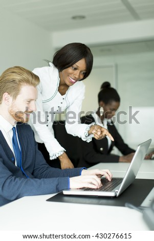 Young business couple working together in the office