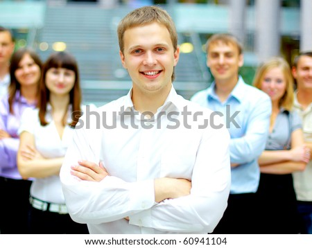 Young business executive - Mature business man with his colleagues in the background - stock photo