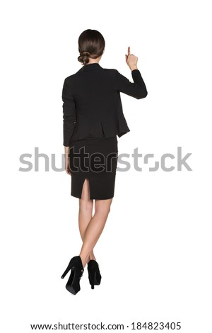 Young business girl pressing smth or showing up - stock photo