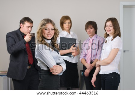 Young business group with businesswoman in office