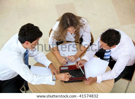 Young business group working at the office with laptop - stock photo