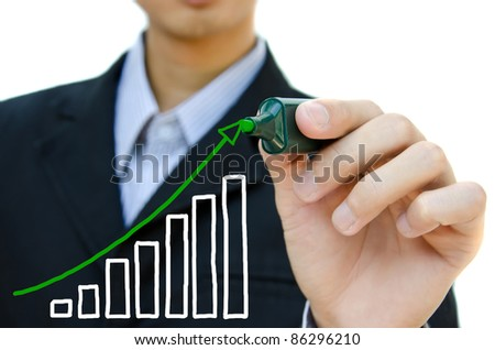 Young business hand drawing showing graph. - stock photo