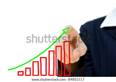 Young business hand pushing showing graph.