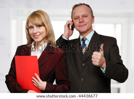 Young business lady and a businessman in the background. - stock photo